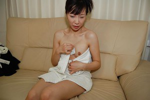 Oriental housewife Kanae Otani taking shower and masturbating hairy pussy