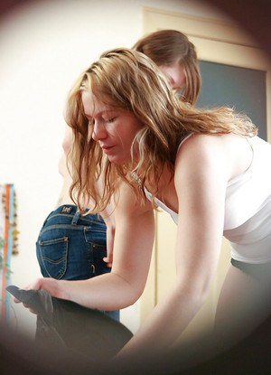Cute lesbians Giselle and Theresa pull on panties and jeans