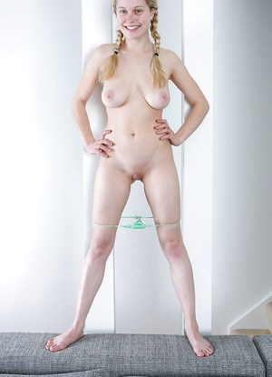 Barely legal blonde chick Rosanna showing off pink labia and clitoris