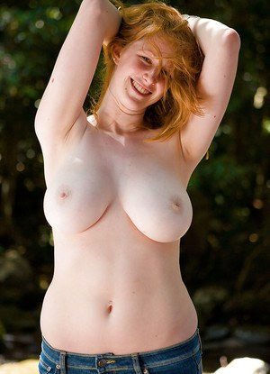 Buxom amateur redhead Chloe B lets her big natural juggs loose outdoors