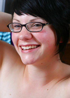 Fat chick with glasses gets undressed and flashes hairy pussy