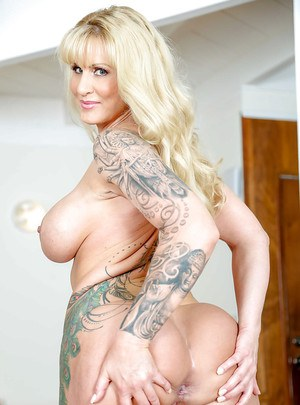 Thick blonde with big tits and tattoos spreads older shaved pussy