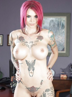 Busty fetish model Anna Bell Peaks undresses to bare heavily inked body