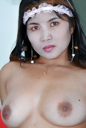 Pretty Latina girl Jenny modelling a French Maid's uniform and baring tits