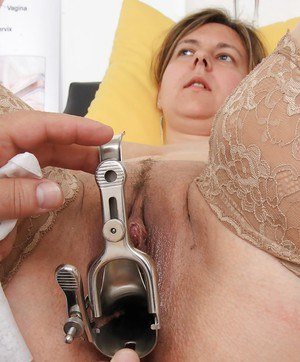 Plump mature woman Iva Wild has hairy cunt checked out by doctor