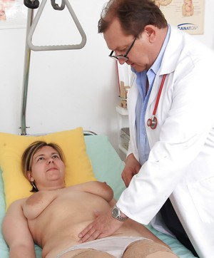 Chubby patient with big saggy tits has hairy cunt stretched by doctor