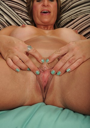 Busty older woman Skyler Haven poses solo in blue bra and panties