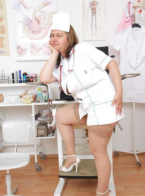 Chubby blonde nurse Iva Wild posing in hot uniform and pantyhose