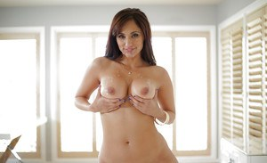 Busty babe Reena Sky squeezing perfect melons together for tit fucking