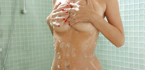 Close up shower shots of the wet and puffy pussy belonging to Natalia Starr