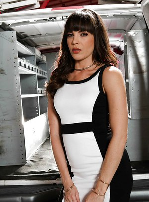 Hot model Dana DeArmond poses outdoors in black nylons and high heels
