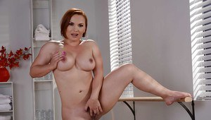 Chunky redhead Katja Kassin strips off bra and panties to spread vagina