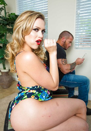 Fully clothed blonde Mia Malkova demonstrates blowjob technique