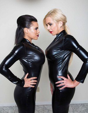 Latex lesbians Luna Star and Nina Elle posing in latex bodysuits