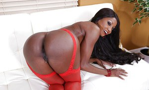 Buxom black woman Diamond Jackson flashes big boobs in red lingerie