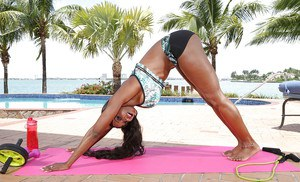 Black yoga instructor Diamond Jackson working out and stripping on beach