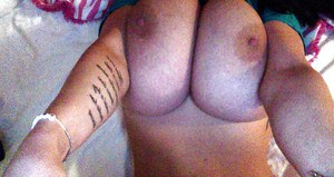 Buxom Euro lady Leanne Crow exposing massive melons in homemade selfies