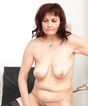 Older woman Remy stripping down to stockings and heels in doctor's office