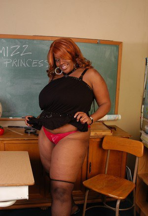 Mature black fatty Princess flashing panties a big fat ass in classroom