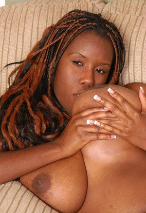 Chubby ebony lady Diva using pierced tongue to suck own nipples