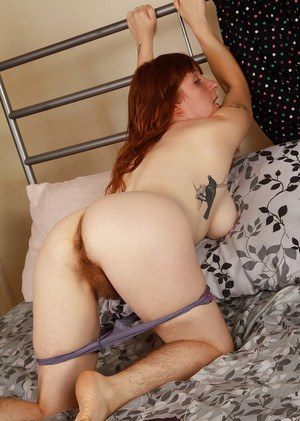 Hirsute model Velma posing hairy legs in heels and spreading beaver