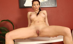 Curvy mature lady Gabriela Red getting undressed for masturbation session