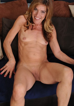Slender MILF over 40 Monique stripping naked and baring shaved pussy