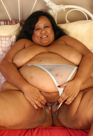 SSBBW Debrina lets fat tits loose from lingerie for nipple licking