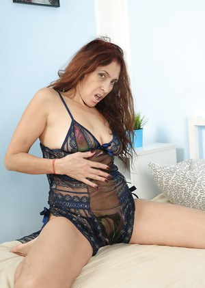 Mature lady Karolina exposing shaved pussy in crotchless lingerie