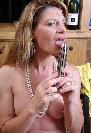 Older blonde woman Linda whipping out vibrator for masturbation action