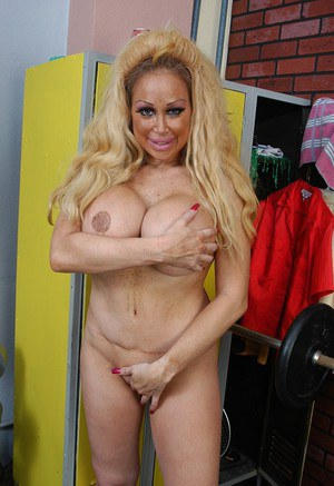 Buxom granny Pamela flaunting huge juggs while working out in weight room