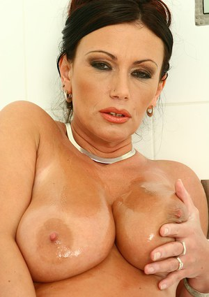 Busty woman Pandora oils big natural tits in shower and spreads pink pussy