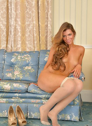 Mature MILF Vanessa Jordan poses fully clothed in pantyhose and high heels