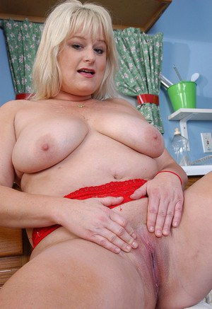 Blonde BBW Lizzy strips off panties to finger shaved pussy in kitchen