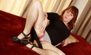 Hirsute older woman Velma spreading her hairy muff wide open