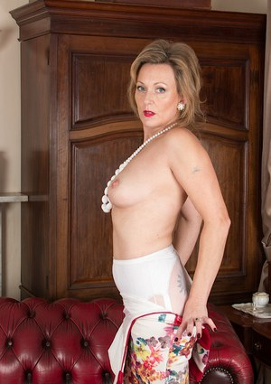 Mature babe over 50 Huntingdon Smyth posing in pantyhose and garters
