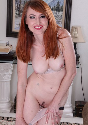 Older redhead Molly Gingham fingering her shaved vagina after stripping