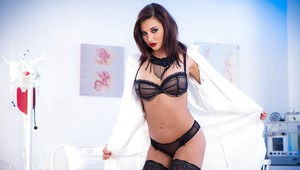Ravishing brunette babe Anna Polina showing off her boobs in stockings
