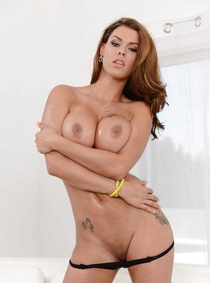 Busty pornstar Peta Jensen spreading her legs and showing off her pussy