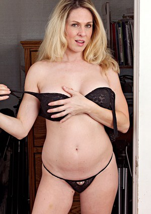 Amazing blonde mature Angela Attison playing with her juicy pussy