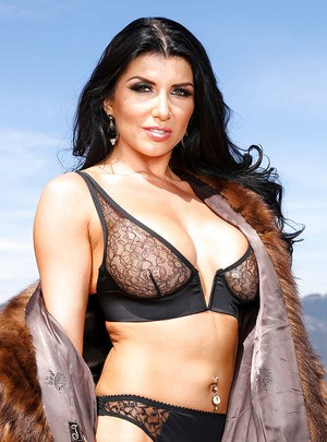 Busty Romanian pornstar Romi Rain spreads pink cunt with sex toy in anus