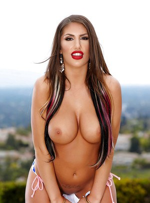 Big tit babe August Ames removes bikini outdoors and flaunts huge hooters