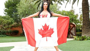 Busty pornstar Nikki Benz poses outdoors in skimpy Canadian flag bikini