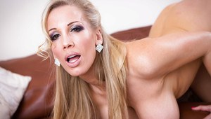 Blonde with big tits Rebecca Moore strips off bra to play with her fun bags