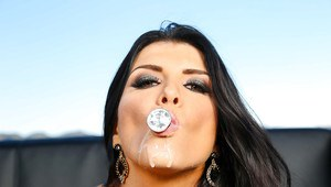 Romanian pornstar Romi Rain on knees licking huge cock with tongue outdoors