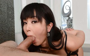Adorable Asian brunette Marica Hase having an orgasm in black stockings