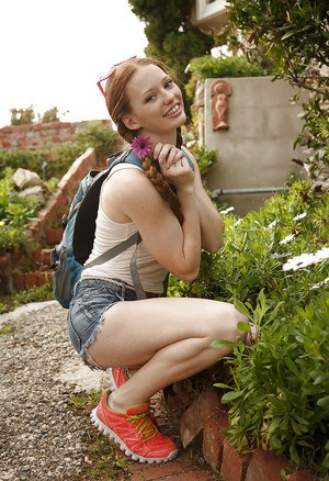 Pigtail wearing redhead teen Wendy Patton having fun exposing herself