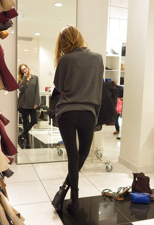 Skinny playful blonde teen Reese Berkman bending over in a store