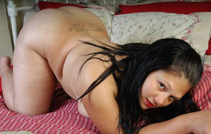 Chubby brunette mature Nancy showing her curves in red lingerie