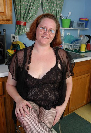 Cute mature fatty Adrienne playing with herself in fishnet stockings